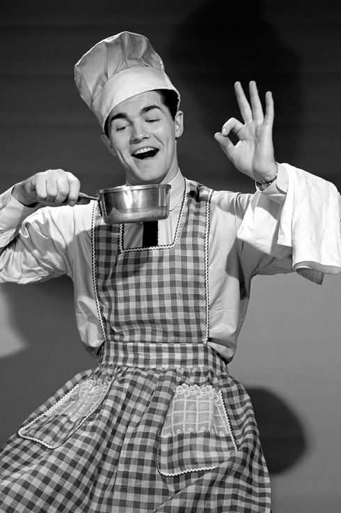 1950s enthusiastic man wearing chefs hat and apron holding pot making okay sign