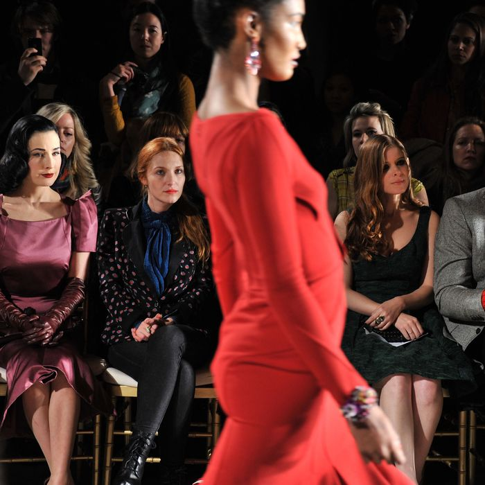 NEW YORK, NY - FEBRUARY 12: (L-R) Stylist Brad Goresk, Dita Von Teese, actress Josephine de La Baum, actress Kate Mara and InStyle Fashion Director Hal Rubenstein attend the Zac Posen Fall 2012 fashion show during Mercedes-Benz Fashion Week at the David Koch Theatre at Lincoln Center on February 12, 2012 in New York City. (Photo by Stephen Lovekin/Getty Images)