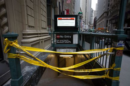 A subway station's entrance is blocked by yellow tape in New York, U.S., on Monday, Nov. 5, 2012. Commuters in New York and New Jersey face gasoline lines and miles of traffic jams as the metropolitan area struggles with the chaos that remains in the wake of superstorm Sandy.