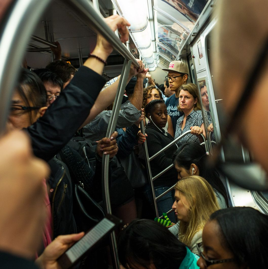 Morning commuters crowd into a Metropolitan Transportation Authority subway car June 10, 2014 in New York City.