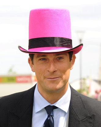 Bear Grylls in a pink top hat; not his Dockers ad, obvs.