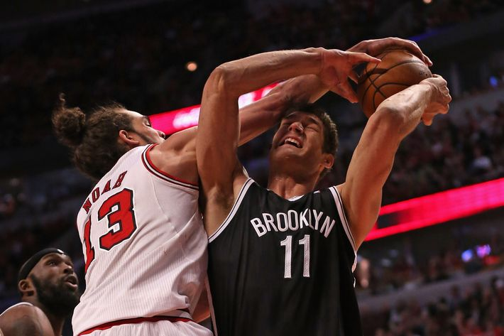 CHICAGO, IL - APRIL 25: Joakim Noah #13 of the Chicago Bulls fouls Brook Lopez #11 of the Brooklyn Nets in Game Three of the Eastern Conference Quarterfinals during the 2013 NBA Playoffs at the United Center on April 25, 2013 in Chicago, Illinois. NOTE TO USER: User expressly acknowledges and agrees that, by downloading and or using this photograph, User is consenting to the terms and conditions of the Getty Images License Agreement. (Photo by Jonathan Daniel/Getty Images)