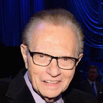 Larry King and David Spade attend