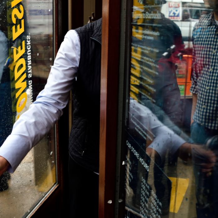 Corporate employees lock the door after an estimated fifty wrapped up a three-hour long protest at the Starbucks location in Center City Philadelphia, PA, USA on April 16, 2018. (Photo by Bastiaan Slabbers/NurPhoto)