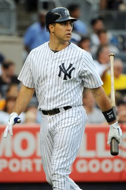 NEW YORK, NY - JULY 28:  Mark Teixeira #25 of the New York Yankees reacts after striking out to end the bottom of the first inning against the Boston Red Sox at Yankee Stadium on July 28, 2012 in the Bronx borough of New York City. (Photo by Christopher Pasatieri/Getty Images)
