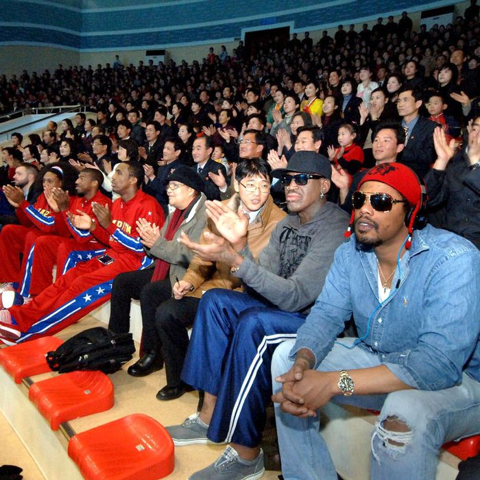 In this image released by the Korean Central News Agency (KCNA) and distributed by the Korea News Service, former NBA star Dennis Rodman, second right in front row, visits a dolphin aquarium in Pyongyang in North Korea Friday, March 1, 2013. Ending his unexpected round of basketball diplomacy in North Korea on Friday, Rodman called leader Kim Jong Un an