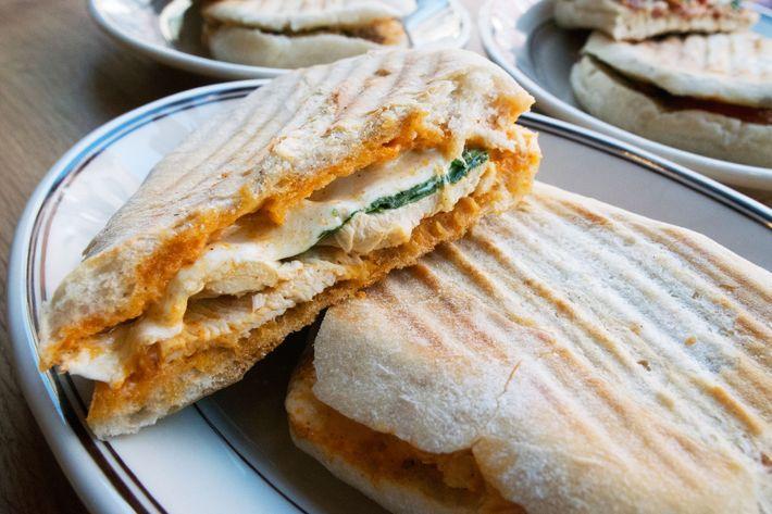 Roast-chicken panino with mozzarella, arugula, and spicy mayo.