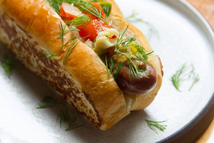 The smoked hot dogs are made on the premises and garnished with housemade mustard and giardiniera.