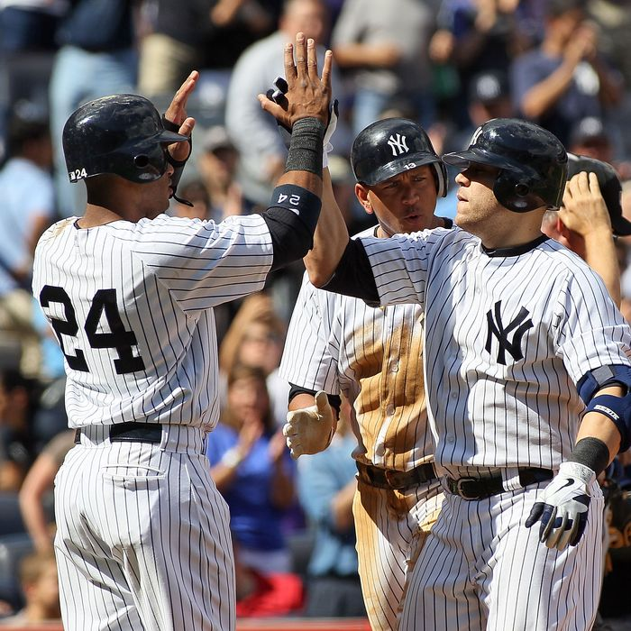 Russell Martin #55 of the New York Yankees (R) celebrates a three run home run with teammates Robinson Cano #24 and Alex Rodriguez #13 against the Tampa Bay Rays at Yankee Stadium on September 16, 2012 in the Bronx borough of New York City.