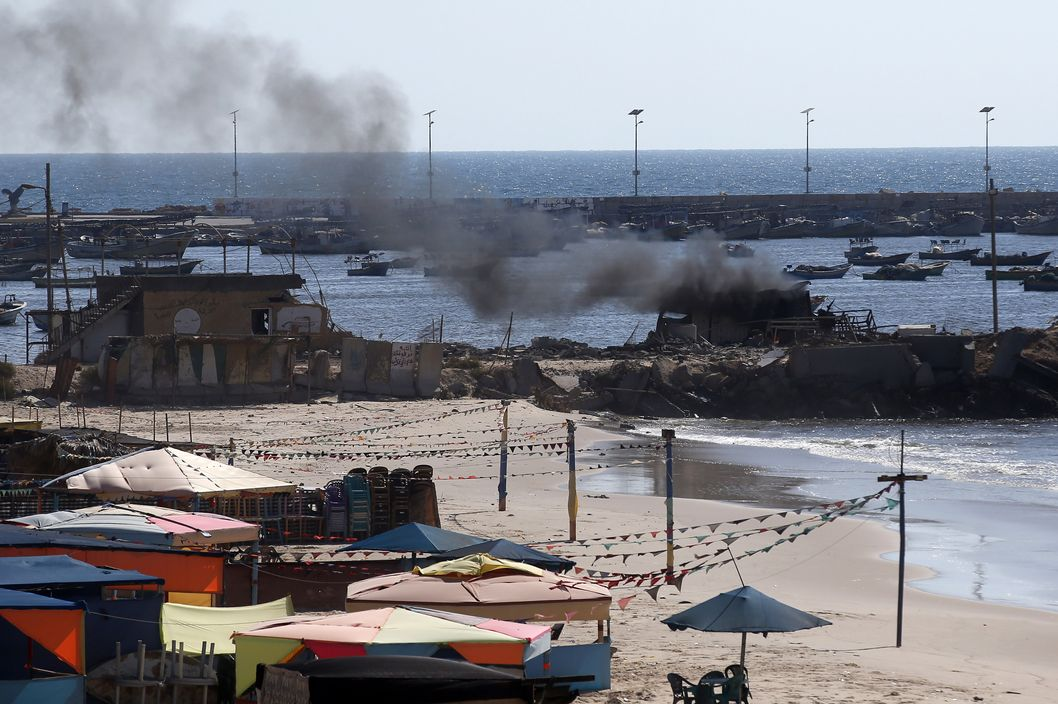 Smoke billows from a beach shack following an Israeli military strike, on July 16, 2014 in Gaza City which killed four children, medics said. All four were on the beach when the attack took place, emergency services spokesman Ashraf al-Qudra said, with several injured children taking refuge at a nearby hotel where journalists were staying. AFP PHOTO / THOMAS COEX        (Photo credit should read THOMAS COEX/AFP/Getty Images)