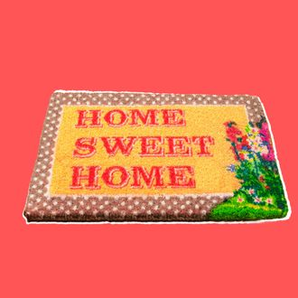 Home sweet home doormat on wooden floor