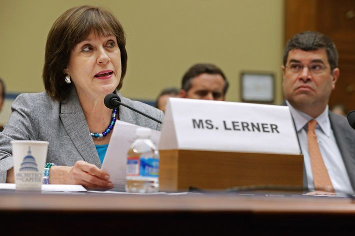 """Internal Revenue Service Director of Exempt Organizations Lois Lerner (L) makes a statement during a hearing of the House Oversight and Government Reform Committee with Deputy Treasury Secretary Neal Wolin May 22, 2013 in Washington, DC. The committee is investigating allegations that the IRS targeted conservative non-profit organizations with the words """"tea party"""" and """"constitution"""" in their names for additional scrutiny. Lerner, who headed the division that oversees exempt organizations, exercised her constitutional right not to answer questions."""
