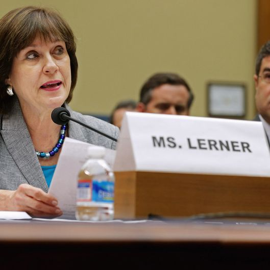 "Internal Revenue Service Director of Exempt Organizations Lois Lerner (L) makes a statement during a hearing of the House Oversight and Government Reform Committee with Deputy Treasury Secretary Neal Wolin May 22, 2013 in Washington, DC. The committee is investigating allegations that the IRS targeted conservative non-profit organizations with the words ""tea party"" and ""constitution"" in their names for additional scrutiny. Lerner, who headed the division that oversees exempt organizations, exercised her constitutional right not to answer questions."