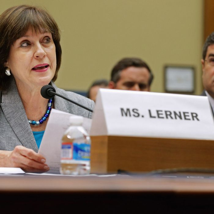 Internal Revenue Service Director of Exempt Organizations Lois Lerner (L) makes a statement during a hearing of the House Oversight and Government Reform Committee with Deputy Treasury Secretary Neal Wolin May 22, 2013 in Washington, DC. The committee is investigating allegations that the IRS targeted conservative non-profit organizations with the words