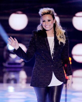 UNIVERSAL CITY, CA - AUGUST 11: Singer Demi Lovato accepts the Choice Female Artist award onstage at the Teen Choice Awards 2013 at the Gibson Amphitheatre on August 11, 2013 in Universal City, California. (Photo by Kevin Winter/Getty Images)