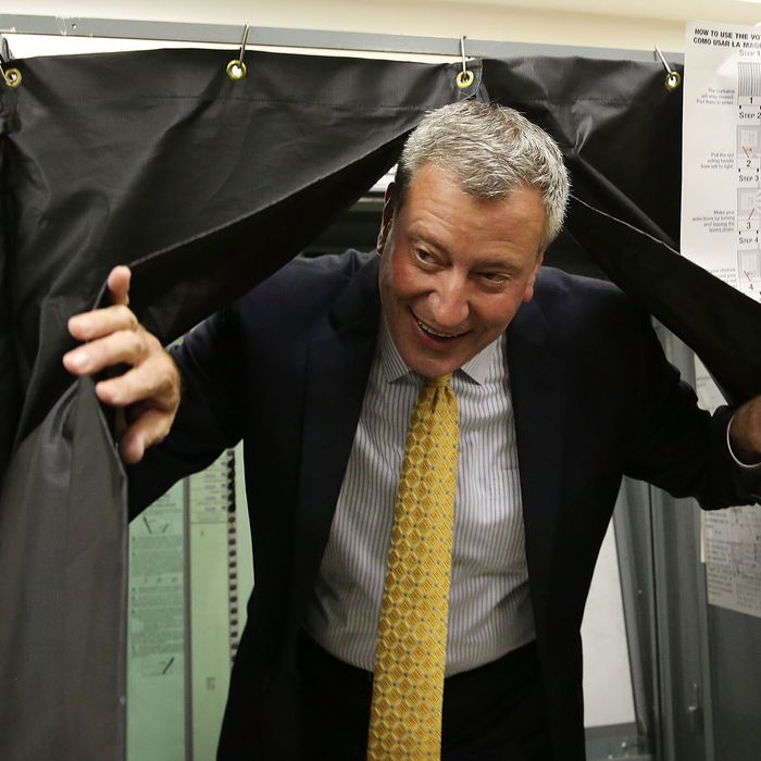 Public Advocate and mayoral candidate Bill de Blasio emerges from a voting booth after voting in the New York City mayoral primary on September 10, 2013 in the Brooklyn borough of New York City. In recent polls by Quinnipiac University, de Blasio is now close to the 40 percent threshold he'd need to avoid a runoff in the Democratic primary.