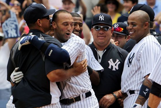NEW YORK, NY - JULY 09:  Derek Jeter #2 of the New York Yankees celebrates at home with teammates Alex Rodriguez #13, Bartolo Colon #40 and Andruw Jones #18  after hitting a solo home run in the third inning for career hit 3000 while playing against the Tampa Bay Rays at Yankee Stadium on July 9, 2011 in the Bronx borough of New York City.  (Photo by Michael Heiman/Getty Images)