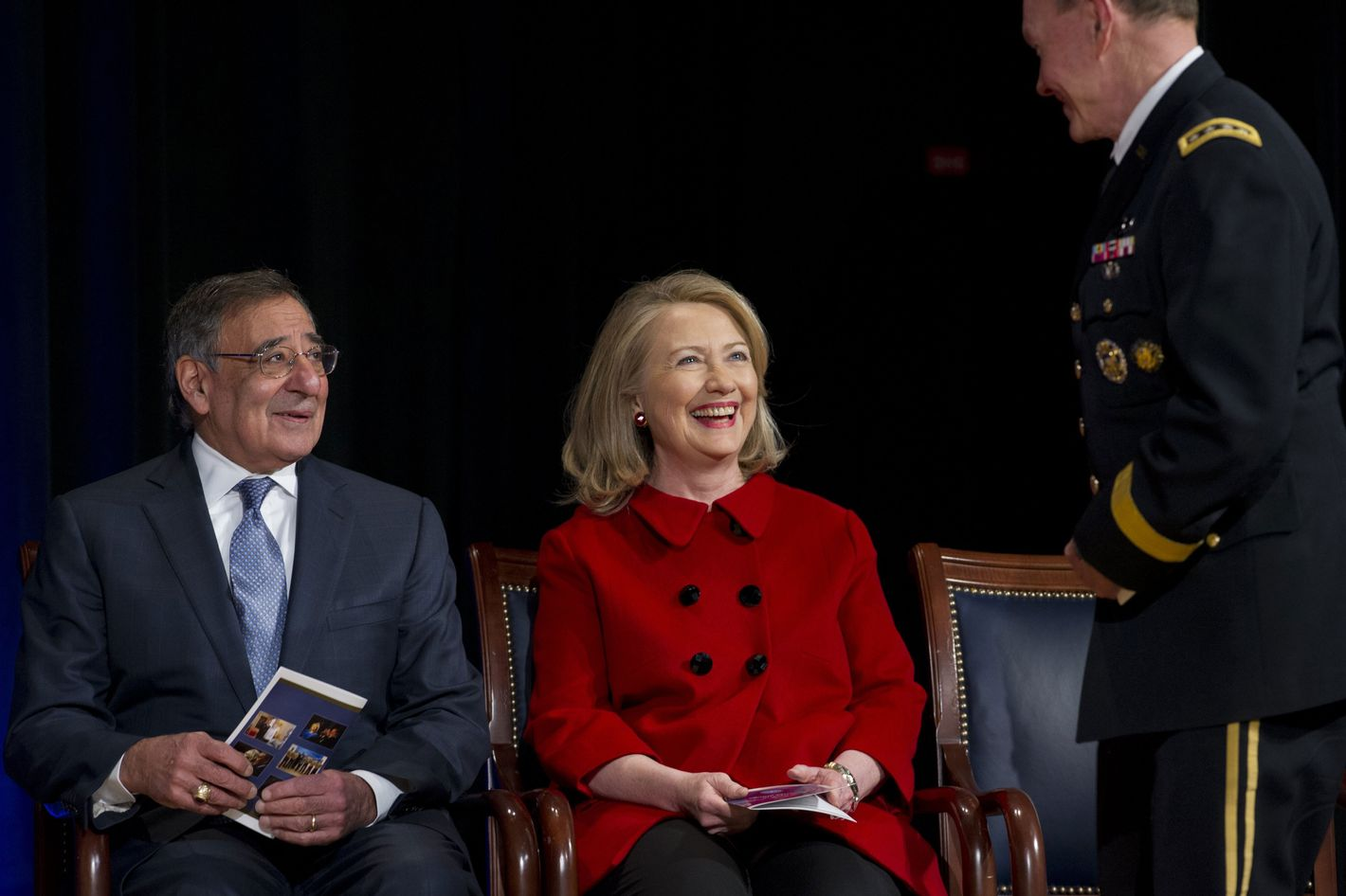 US Secretary of Defense Leon Panetta and former Secretary of State Hillary Clinton speak with Chairman of the Joint Chiefs Martin Dempsey (R) prior to Clinton receiving awards from Panetta and Dempsey during a ceremony at the Pentagon in Washington, DC, February 14, 2013.