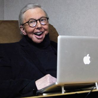 Pulitzer Prize-winning movie critic Roger Ebert works in his office at the WTTW-TV studios in Chicago. In an essay posted Tuesday, April 2, 2013, Ebert says that he has cancer again and is scaling back his movie reviews while undergoing radiation. The veteran critic has previously battled cancer in his thyroid and salivary glands and lost the ability to speak and eat after surgery.