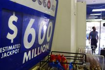 "An advertising board shows the record jackpot of the Powerball US lottery with a record jackpot of 600 million US Dollars in a shop in downtown Washington, DC on May 17, 2013.  In a statement, the Iowa state lottery agency said the Pawerball jackpot -- played in 43 states -- now is ""the largest in the 21-year history of the game"" as well as the second-largest in world lottery history."