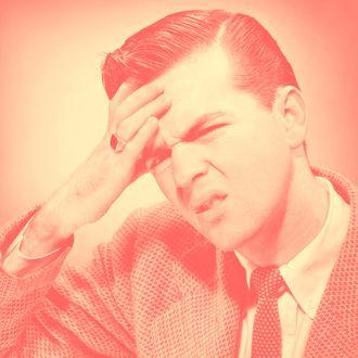 Man touching forehead, suffering headache.