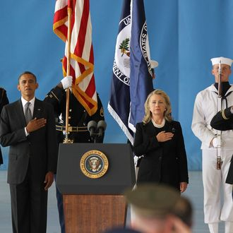 JOINT BASE ANDREWS, MD - SEPTEMBER 14: U.S. President Barack Obama (2nd L) and U.S. Secretary of State Hillary Clinton (3rd R) hold their hands over their hearts during the Transfer of Remains Ceremony for the return of Ambassador Christopher Stevens and three other Libyan embassy employees at Joint Base Andrews September 14. 2012 in Joint Base Andrews, Maryland. Stevens and the three other embassy employees were killed when the consulate in Libya was attacked September 11. (Photo by Molly Riley-Pool/Getty Images)