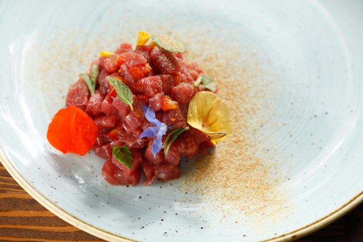 Lamb tartare with shrimp salt and egg yolk.
