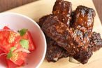 Glazed pork ribs with watermelon salad.