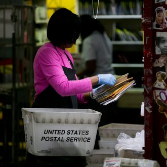 U.S. Postal Service employee Terrie Williams sort mail before delivery at the Brookland Post Office in Washington, D.C., U.S., on Thursday, May 9, 2013. The USPS is projecting a loss of as much as a $6 billion for the year as it keeps pressure on Congress for help, Postmaster General Patrick Donahoe said this month. The service is scheduled to release second-quarter results May 10. Photographer: Andrew Harrer/Bloomberg via Getty Images