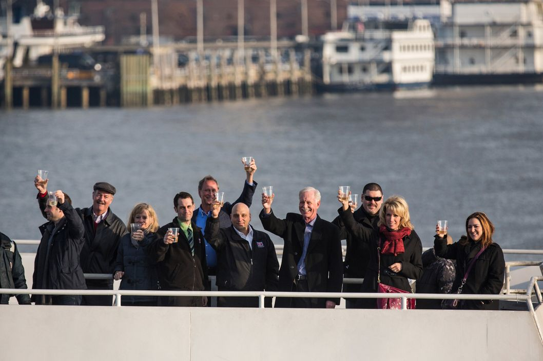 "Chesley ""Sully"" Sullenberger, a retired airline captain famous for landing a commercial jet on the Hudson River, along with passengers and crew members from the flight, raise glasses of champagne on a New York Waterway ferry in the middle of the Hudson River to celebrate the five year anniversary of ""The Miracle on the Hudson"" at a press conference and photo opportunity on January 15, 2014 in New York City. On January 15, 2009, Sullenberger took off from La Guardia airport while piloting US Airways Flight 1549 with 150 passengers and five crew members. The plane hit a goose shortly after take off, forcing Sullenberger to land the plane in the Hudson River; no one was killed."
