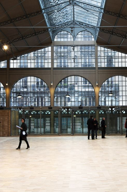 Visitors walks through the renovated Carreau du Temple market on February 20, 2014 in Paris.