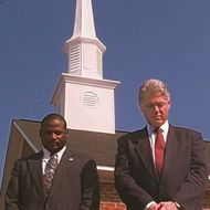 US President Bill Clinton (R) and Rev. Terrence Ma