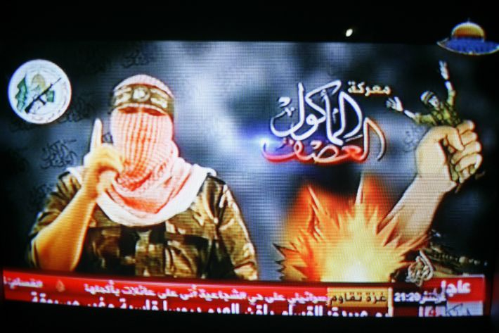 Rafah, Palestinian Territory. 21st July 2014 -- Abu Ubaida, a spokesman for the Izz al-Din al-Qassam Brigades, the armed wing of Hamas, announces the capture of an Israeli soldier during a broadcast shown on a Hamas television channel. -- Abu Ubaida, a masked spokesman of the Izz el-Deen al-Qassam Brigades, the armed wing of Hamas, announces the capture of an Israeli soldier during a broadcast on a Hamas television channel.