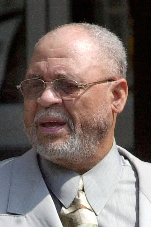 Ed Martin, a retired Ford Motor Co. electrician accused of lending more than $600,000 to four Michigan basketball players from 1988-1999, pleaded guilty Tuesday, May 28, 2002, to a federal conspiracy charge. Martin, who is shown leaving federal court in Detroit Tuesday and who prosecutors say loaned the money to help conceal profits from gambling operations at Detroit-area auto plants, faces 30-37 months in prison under guidelines to which he and prosecutors agreed.