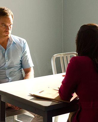 Michael C. Hall as Dexter Morgan and Lauren Velez as Maria LaGuerta in Dexter (Season 7, episode 12)