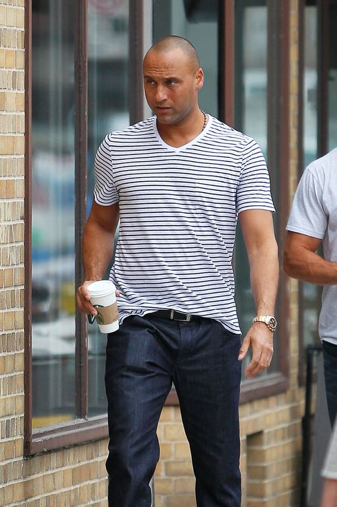 Derek Jeter seen leaving his house and walking to get coffee at Starbucks.
