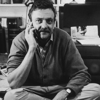 15th March 1969: American author Kurt Vonnegut Jr sitting cross-legged on hardwood floors while smoking a cigarette at his home at Barnstable, Cape Cod, Massachusetts. (Photo by Israel Shenker/New York Times Co./Getty Images)
