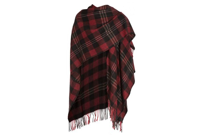 aa568a3f70949 A splurge for in-between weather, when all you need is a light layer to  keep cozy. Balenciaga Tartan cashmere and wool-blend poncho, $945 at Net-a -Porter