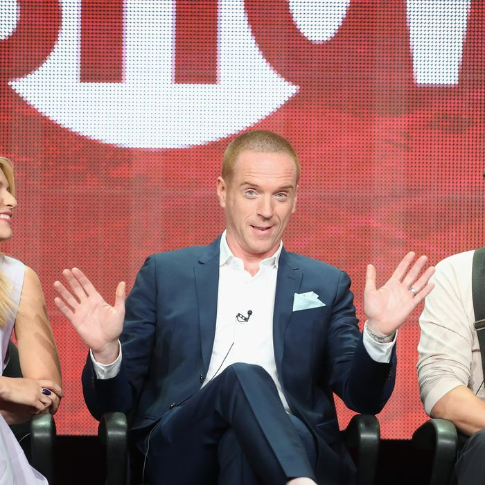 BEVERLY HILLS, CA - JULY 29: (L-R) Actors Claire Danes, Damian Lewis and Rupert Friend speak onstage during the