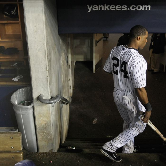 NEW YORK, NY - OCTOBER 06: Robinson Cano #24 of the New York Yankees walks out of the dugout dejected towards the clubhouse after they lost 3-2 agaisnt the Detroit Tigers during Game Five of the American League Championship Series at Yankee Stadium on October 6, 2011 in the Bronx borough of New York City. (Photo by Nick Laham/Getty Images)