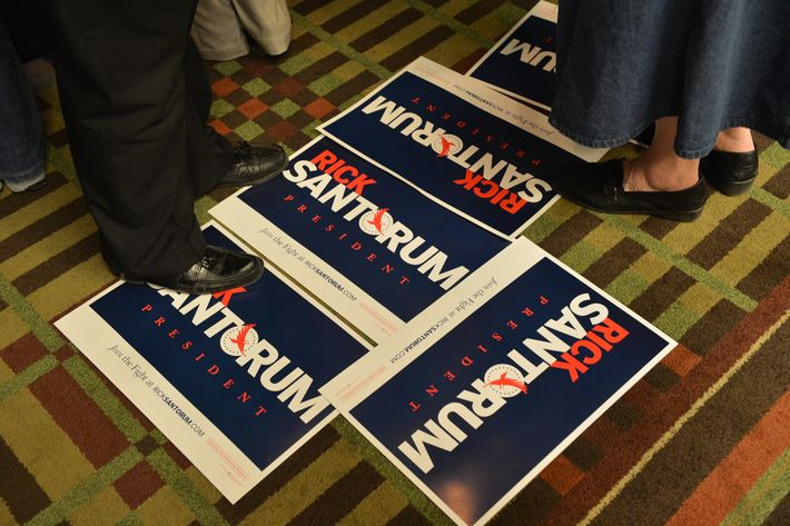 Campaign posters lie idle as preparations are made shortly before a primary night campaign rally for Republican presidential candidate Rick Santorum April 3, 2012 at the Four Points Sheraton Hotel in Mars, Pennsylvania. Republican primaries are being held April 3rd in Wisconsin, Maryland, and Washington, DC.           AFP Photo/Paul J. Richards (Photo credit should read PAUL J. RICHARDS/AFP/Getty Images)