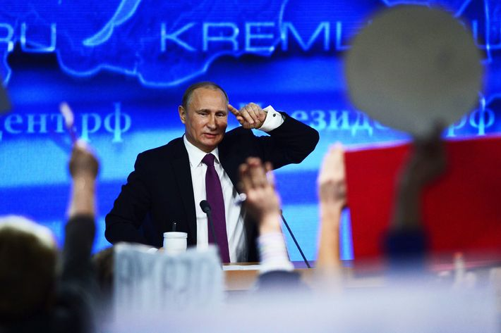 Russian President Vladimir Putin answers the questions of press during an annual evaluation session in Moscow, Russia, on December 18, 2014.