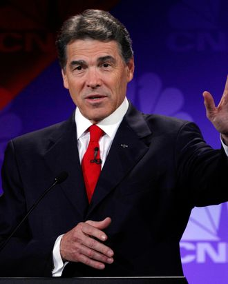 Republican presidential candidate Texas Gov. Rick Perry speaks during a Republican Presidential Debate at Oakland University in Auburn Hills, Mich., Wednesday, Nov. 9, 2011. (AP Photo/Paul Sancya)