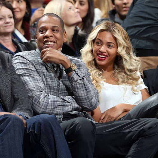 Jay-Z and Beyonc? sit courtside during the Oklahoma City Thunder game against the Los Angeles Clippers on November 21, 2013 at the Chesapeake Energy Arena in Oklahoma City, Oklahoma.