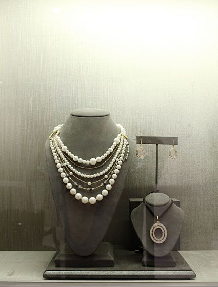 Multi-strand pearl, diamond, and stone yellow-gold necklace with large oval diamond clasp, $12,000; small oval diamond earrings, $5,600; large oval diamond pendant on silk cord, $11,500.