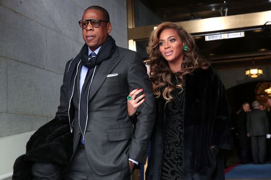 Jay-Z and Beyonce arrive at the presidential inauguration on the West Front of the U.S. Capitol January 21, 2013 in Washington, DC. Barack Obama was re-elected for a second term as President of the United States.