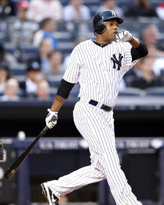 Dewayne Wise #45 of the New York Yankees watches his two run homer against the Cleveland Indians on June 25, 2012