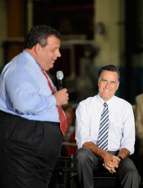 Chuckling to himself while staring at Christie's waistline.
