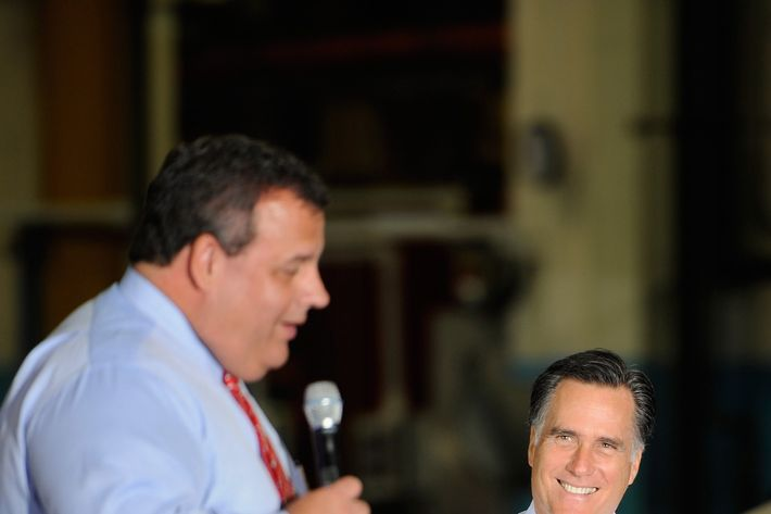 MOUNT VERNON, OH - OCTOBER 10:  Republican presidential candidate, former Massachusetts Gov. Mitt Romney (R) listens as New Jersey Gov. Chris Christie speaks to the crowd at Ariel Corporation on October 10, 2012 in Mount Vernon, Ohio. Romney is campaigning in Ohio with less than a month to go before the general election.   (Photo by Jamie Sabau/Getty Images)