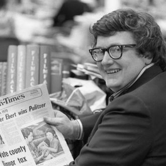 Roger Ebert, of the Chicago Sun-Times, whose film reviews are a feature of the Chicago paper and is syndicated to 100 other newspapers throughout the country holds a copy of the Sun-Times announcing his winning of the Pulitzer Prize for Criticism